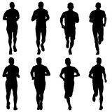 Set of silhouettes. Runners on sprint, men. vector illustration. Set of silhouettes Runners on sprint men vector illustration Stock Photo