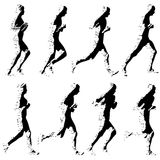 Set of silhouettes. Runners on sprint, men and woman.  Stock Image