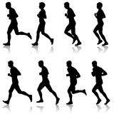 Set of silhouettes. Runners on sprint, men and woman.  Stock Photography