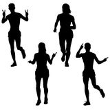 Set of silhouettes. Runners on sprint men and woman. Vector illustration.  Stock Image
