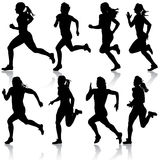 Set of silhouettes. Runners on sprint, women. Stock Images