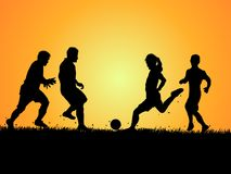 Set of Silhouettes of soccer player and grass. On gradient background Stock Photo