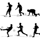 Set silhouettes of soccer players with the ball. Royalty Free Stock Image