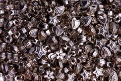 Set of silver beads of different shapes close-up stock photography