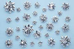 Set of silver bows on blue Stock Images