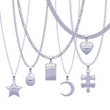 Set of silver chains with different pendants. Stock Images