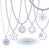 Set of silver chains with flower pendants. Stock Images
