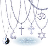 Set of silver chains with religious pendants. Royalty Free Stock Images