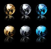 Set of silver, gold and blue globe in black Stock Photo