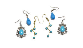 Set of Silver and Gold Earrings with Turquoise Beads Royalty Free Stock Image