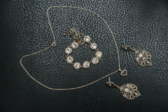 Set of silver jewelry from chains, rings and bracelet Stock Photography