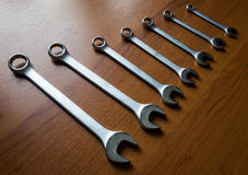 Silver  metal wrenches. The Set of silver metal wrenches on a wooden background Stock Images