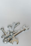 Set of silver metallic spanners, isolated objects. Pile of wrenc Stock Image