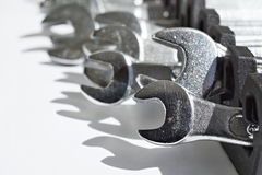 Set of silver monkey wrenches (shifting or adjustable spanners) as a symbol of manual construction Royalty Free Stock Photos