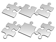 Set of silver puzzles flying to air Royalty Free Stock Images