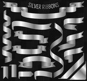 Set of silver ribbons on carbon background Royalty Free Stock Images