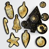 Set of Simple  christmas elements with black paper tree, balls and snowflakes in gold style Stock Photos