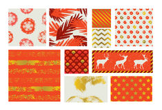 Set of simple christmas patterns in red shades with gold elements. Stock Photos