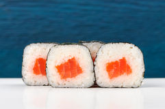 Set of simple japanese rolls with salmon, rice and nori on deep Stock Image