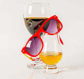 Set of single malt tasting glass and wineglass, sunglasses, sing Royalty Free Stock Photo