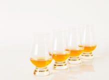 Set of single malt tasting glasses, single malt whisky in a glas. Ses, white background, exclusive set Royalty Free Stock Photos