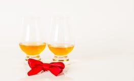 Set of single malt tasting glasses, single malt whisky in a glasses, white background. Exclusive set stock photography