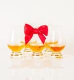 Set of single malt tasting glasses, single malt whisky in a glasses, white background. Exclusive set royalty free stock photo