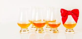 Set of single malt tasting glasses, single malt whisky in a glasses, white background. Exclusive set royalty free stock photos
