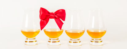 Set of single malt tasting glasses, single malt whisky in a glasses, white background. Exclusive set royalty free stock images
