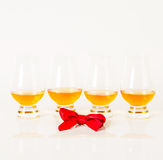 Set of single malt tasting glasses, single malt whisky in a glasses, white background. Exclusive set stock image