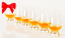 Set of single malt tasting glasses, single malt whisky in a glasses, white background. Exclusive set royalty free stock image