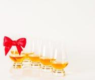 Set of single malt tasting glasses, single malt whisky in a glasses, white background. Exclusive set stock photo