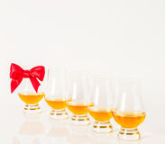 Set of single malt tasting glasses, single malt whisky in a glasses, white background. Exclusive set royalty free stock photography