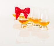 Set of single malt tasting glasses, single malt whisky in a glasses, white background. Exclusive set stock images