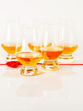 Set of single malt tasting glasses, single malt whisky in a glasses, white background, red bow. Exclusive set stock images