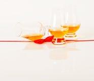 Set of single malt tasting glasses, single malt whisky in a glasses, white background, red bow. Exclusive set stock photo