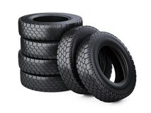 Set of six big vehicle truck tires stacked. Royalty Free Stock Image