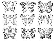 Set of six black butterflies contours over white Stock Photos