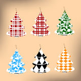 Set of six Christmas trees, fabric. On a yellow background Stock Photography
