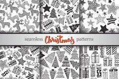 Set of six Christmas vector seamless patterns. Set of six vector seamless patterns with hand drawn ornate presents, stars and Christmas trees. Collection of stock illustration
