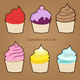 Set of six cute colorful stylized cupcakes with frosting, icing and sprinkles. Red velvet, vanilla, blueberry, rose, lemon and teal variations Stock Images