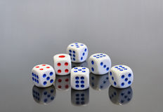 Set of six dices. Thrown on a gray background Stock Photo