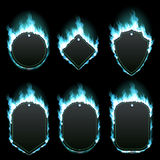 Set of six frames surrounded with azure flame. Set of six frames of different shapes with text space surrounded with realistic azure flame isolated on black Royalty Free Stock Photo