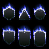 Set of six frames surrounded with blue flame. Set of six frames of different shapes with text space surrounded with realistic blue flame isolated on black Stock Photography