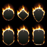 Set of six frames surrounded with flame. Set of six frames of different shapes with text space surrounded with realistic flame isolated on black background Stock Photography