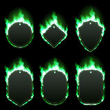 Set of six frames surrounded with green flame. Set of six frames of different shapes with text space surrounded with realistic green flame isolated on black Royalty Free Stock Photo
