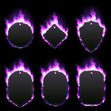 Set of six frames surrounded with purple flame. Set of six frames of different shapes with text space surrounded with realistic purple flame isolated on black Stock Image