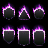 Set of six frames surrounded with purple flame. Set of six frames of different shapes with text space surrounded with realistic purple flame isolated on black Royalty Free Stock Photo