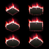Set of six frames surrounded with red lame. Set of six frames of different shapes with text space surrounded with realistic red flame isolated on black Stock Photos