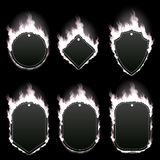 Set of six frames surrounded with white flame. Set of six frames of different shapes with text space surrounded with realistic white flame isolated on black Stock Photography